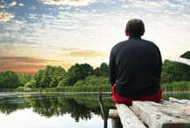 Person overlooking lake.